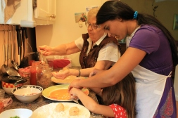 Three generations make Sicilian rice balls at our house