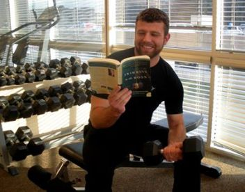 Hunky guy reads second book